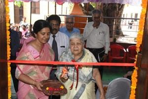 Manisha Singh, left, stands next to her mother-in-law as she cuts the ribbon to inaugurate the renovated chemistry lab  at the Boys' Anglo Bengali Intermediate College in Lucknow . Singh donated money from her late husband's insurance for the initiative.