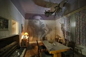 Haunting yet beautiful: A street artist paints walls of abandoned...