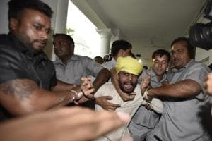 Men beaten up in Delhi assembly name 10 AAP MLAs in high court