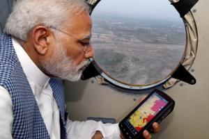 14 die as floods wash over Gujarat, Rajasthan; PM Modi inspects...