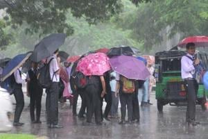 School children returning home in heavy rain in Ranchi