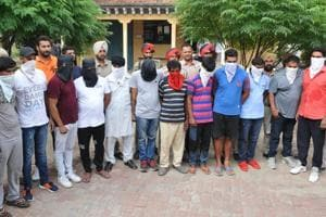 Police officials with the drug peddling accused in Jalandhar on Wednesday, July 26.