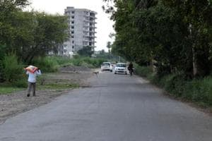 As per the Punjab Municipal Act 1976, a civic body by way of resolution in the general House can pass with majority widening of a road or cutting down its width.