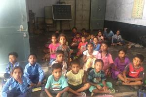 Students sitting on the floor in Government Primary School, Jeevan Nagar, Faridkot.