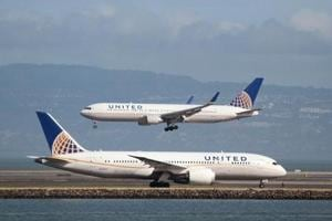 Woman forced to carry child on lap sues United Airlines