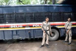 Police escort a bus carrying arrested All Parties Hurriyat Conference (APHC) leaders at Patiala House Court in New Delhi on July 25, 2017.