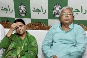 RJD chief Lalu Prasad with wife Rabri Devi at the legislative party meeting, in Patna.