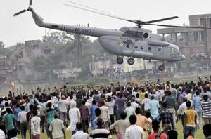 An IAF helicopter takes off with Prime Minister Narendra Modi after he addressed an election rally in Bihar in 2015.