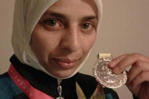 Abida Akhtar with the medal she won in the 48kg (sanshou event) at the Malaysia Wushu International Championships.