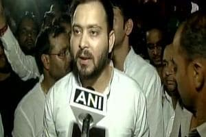 Tejashwi Yadav led a large group of RJD leaders and supporters to the Raj Bhavan.