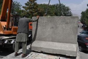 'Born free': War-torn Kabul pulls down concrete blast walls