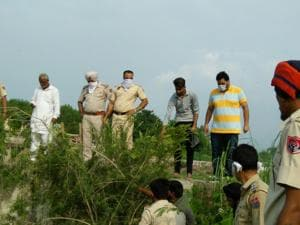 Police officials and villagers during the search operation at Kangna village in SBS Nagar on Wednesday.
