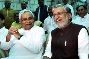 Bihar deputy chief minister Sushil Kumar Modi (R) with chief minister Nitish Kumar after the oath taking ceremony at Raj Bhawan in Patna on Thursday.