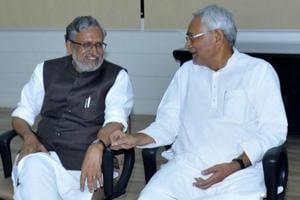 Bihar chief minister Nitish Kumar with senior BJP leader Sushil Kumar Modi at a meeting in Patna on Wednesday.