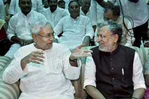 Nitish Kumar with senior BJP leader Sushil Kumar Modi at an oath taking ceremony, at Raj Bhawan in Patna.