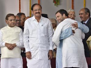 RJD Chief Lalu Yadav hugs Congress vice president Rahul Gandhi during oath taking ceremony of Nitish Kumar in 2015.