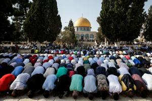 Palestinian Muslims enter Jerusalem holy site for first time in two...
