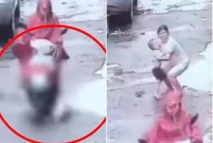 The CCTV footage shows the boy running out in front of the woman who rides over him and races away from the scene (Youtube/Screengrab)