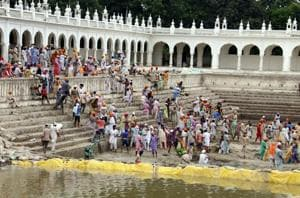 Devotees cleaning Gurusar Sarovar at Takhat Sri Damadma Sahib in Talwandi Sabo.