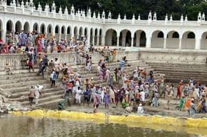 Devotees cleaning Gurusar Sarovar at Takhat Sri Damadma Sahib in Talwandi Sabo.