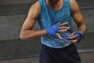 Photos: National boxing medallist struggles as paperboy in Pune