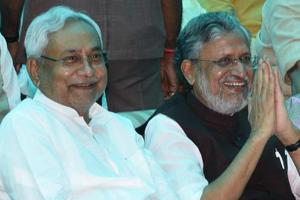 Bihar chief minister Nitish Kumar (left) with BJP leader Sushil Modi at the Raj Bhawan in Patna on Thursday.