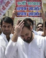 RJD leaders Tejashwi Yadav and Tej Pratap Yadav after the trust vote in Bihar assembly, in Patna on Friday.