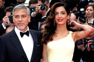George Clooney promises to sue French magazine for publishing images...