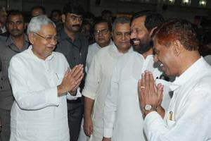 Bihar chief minister Nitish Kumar with Union minister Rambilas Paswan at the swearing-in ceremony at Rajbhawan in Patna on July 29, 2017.