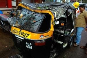 The autorickshaw that got damaged after the tree feel on it.