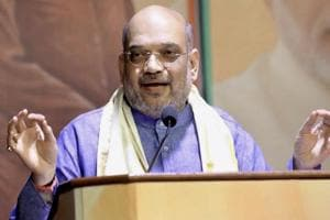 BJP national president Amit Shah rebukes a party worker for calling Congress vice president Rahul Gandhi 'Pappu.'
