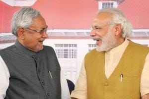A file photo of  Prime Minister Narendra Modi with Bihar chief minister Nitish Kumar at programme in Patna. Opposition parties are criticising Bihar chief minister Nitish Kumar for resigning and taking oath again in less than 24 hours.