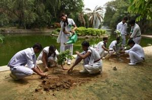 Students of NDMC schools during a plantation drive at Lodhi Garden in New Delhi on July 15.
