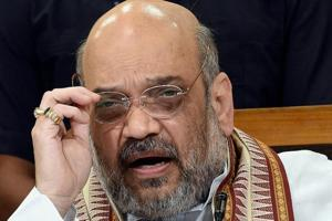 BJP president Amit Shah addresses a press conference at the party office in Lucknow.
