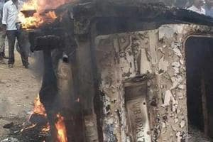 A photo taken on June 30 shows a vehicle on flames after it was  set ablaze by a mob over rumours that the driver was carrying beef. Several people have been killed or attacked by mobs in Jharkhand over the past few months.