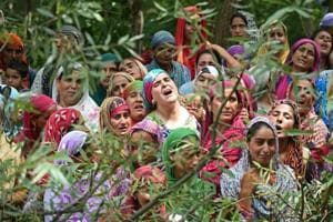 Relatives of a Kashmiri civilian mourn during his funeral at Begum Bagh in Pulwama, south of Srinagar, on Tuesday. Two civilians were killed and dozens injured when security forces fired on protester.