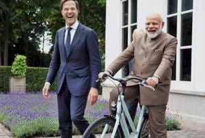 Prime Minister Narendra Modi with a bicycle gifted to him by Dutch Prime Minister Mark Rutte, in The Hague, Netherlands in Julast months in June.