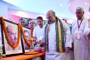 BJP national president Amit Shah paying tributes to RSS ideologues Syama Prasad Mukherjee and Pt Deen Dayal Upadhyay in Rohtak.