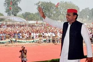 Former Uttar Pradesh CM Akhilesh Yadav waves at people during an election rally in Ballia district.