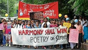 "Some 100 odd studentstook out a march, with the theme ""Harmony Shall Win,"" through campus visiting Ramjas College, Hindu College and Kirori Mal College, protesting against the allegedly growing number of violent incidents on campus."