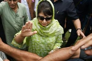 Jammu and Kashmir Chief Minister and PDP President Mehbooba Mufti waves to supporters during party