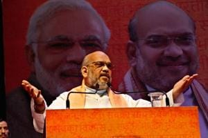 BJP national president Amit Shah addresses party workers in Rohtak.