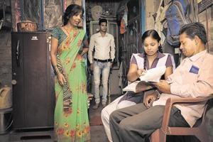 Class 12 student Nikki Chandrashekhar with her parents before leaving for school, in Sangam Vihar, New Delhi.
