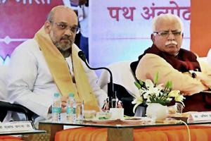 BJP National President, Amit Shah with Haryana Chief Minister Manohar Lal Khattar at a meeting of Pt. Deendayal Upadhyaya Karya Vistar Yojana in Rohtak on August 4, 2017.