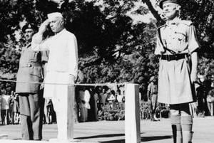 Jawaharlal Nehru salutes the Indian flag as he becomes independent India