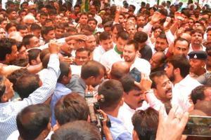 RJD leader Tejashwi Prasad Yadav (centre) with supporters at Gandhi memorial, Motihari, on Wednesday.