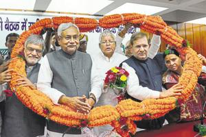 Bihar chief minister Nitish Kumar and JD(U) colleague Sharad Yadav flank RJD chief Nitish Kumar (centre) during a Grand Alliance event in November, 2015. Yadav and party leaders loyal to him are angry with Kumar for breaking the so-called Grand Alliance.