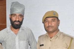 Mannu Punjabi (left) is wanted in cases of liquor smuggling and possession of illegal arms.