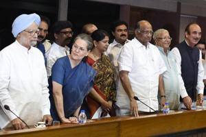 Former PM Manmohan Singh, Sonia Gandhi and NCP leader Sharad Pawar during an all-opposition party meeting in New Delhi, in June this year.