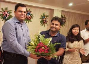 Buxar district magistrate Mukesh Kumar Pandey (left) receiving bouquet from Katihar district magistrate Mithilesh Mishra recently.